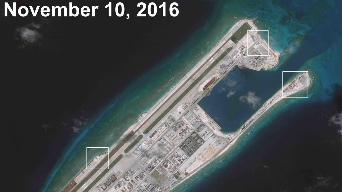 """China's military emplacement on Fiery Cross Reef includes """"four structures, consisting of tiered hexagonal towers oriented toward the sea,"""" according to the Asia Maritime Transparency Initiative."""