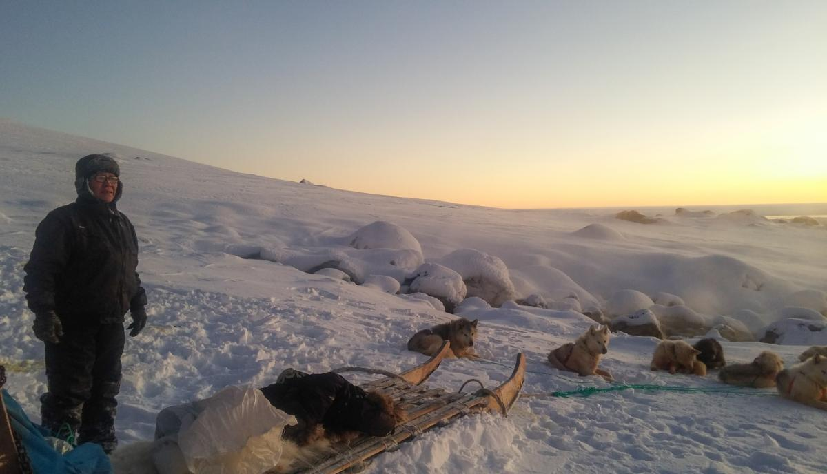 Isak Pike, 60, has lived in Ittoqqortoormiit his entire life. He hunts the traditional Inuit way, by dogsled. Here, he and his dogs rest at a hot spring at Kap Tobin, a starting point for hunters tracking seals, polar bears and other animals.