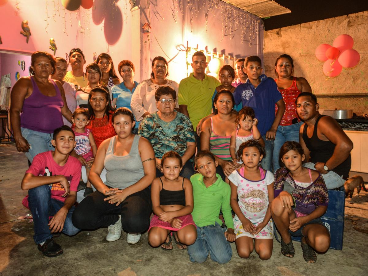 Members of the Barrios family pose for a family portrait during a birthday party at a family home in Cagua, Venezuela. Nine men in the Barrios family have been allegedly murdered by the police. The party was largely attended by female family members — w