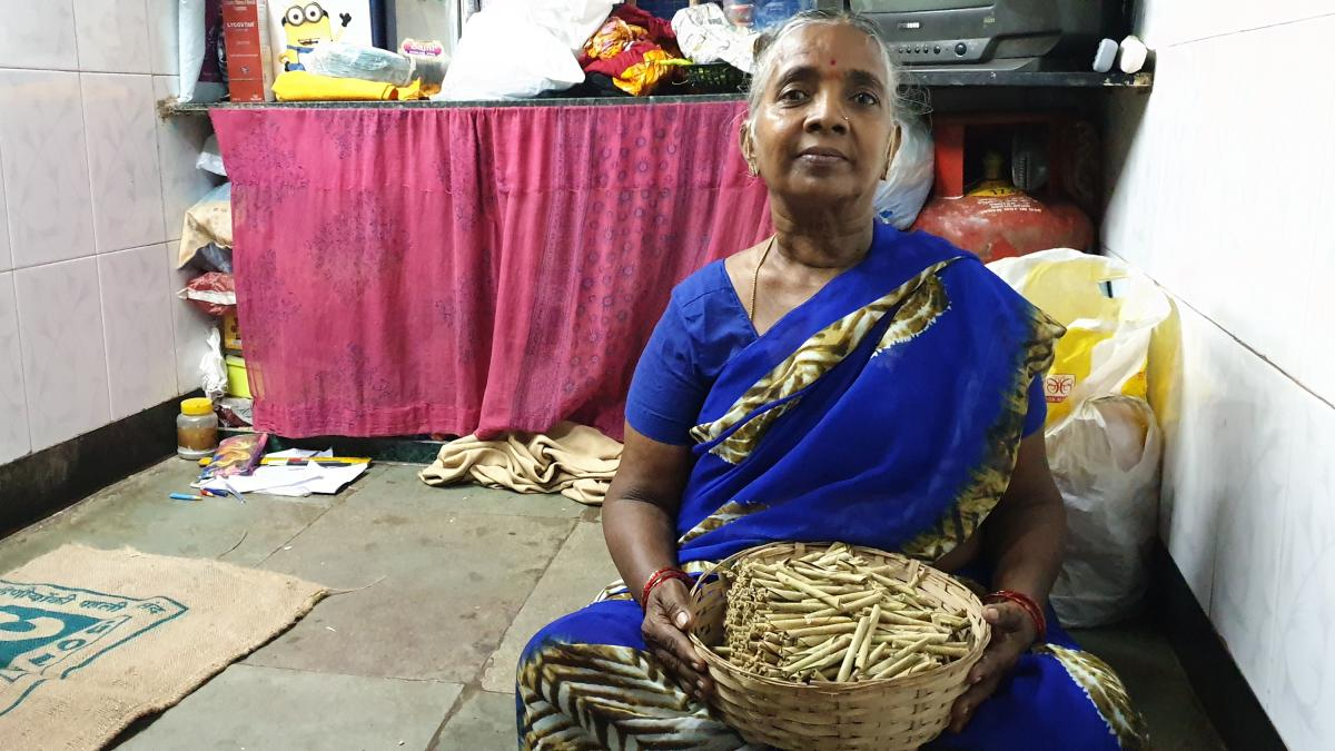 Balamani Sherla, 60, rolls beedis (leaf cigarettes) in her one-room home in Mumbai's red light district. It's the only job she's ever had, and she's been doing it for 50 years. She breathes tobacco dust all day, and earns about 14 cents an hour.