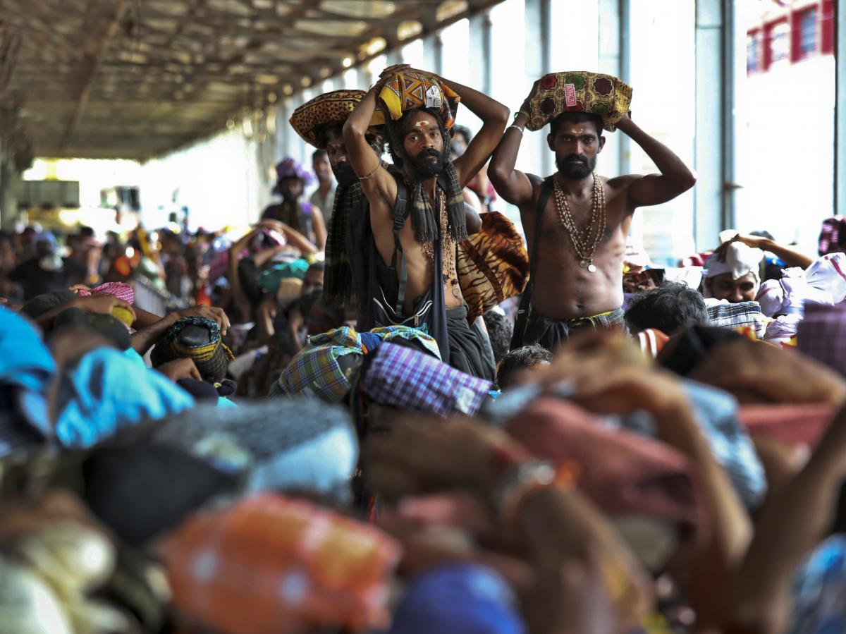 Devotees carry offerings on their heads and wait to worship at the Sabarimala temple in November.