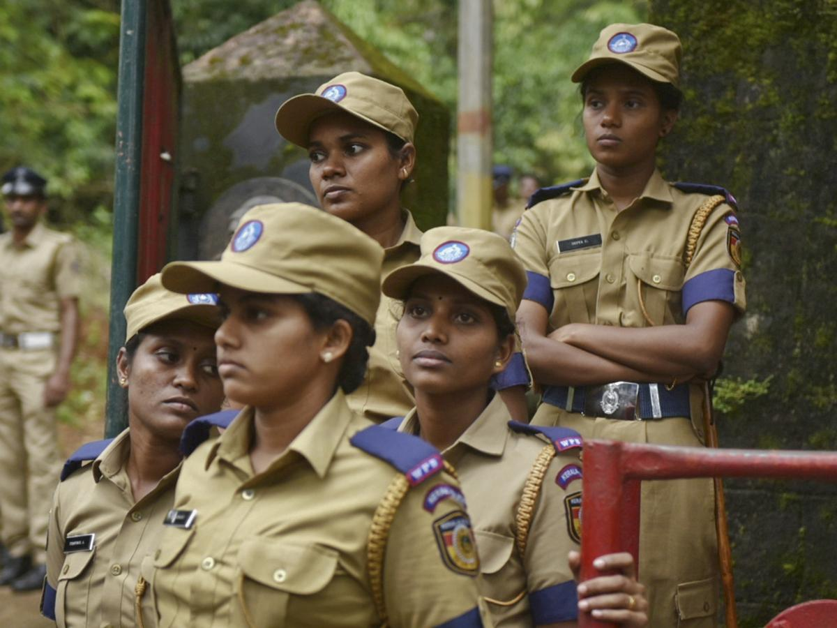 Female police personnel keep an eye on protesters blocking the path of women going to the Sabarimala temple at Nilakkal, a base camp on the way to the temple, in October.