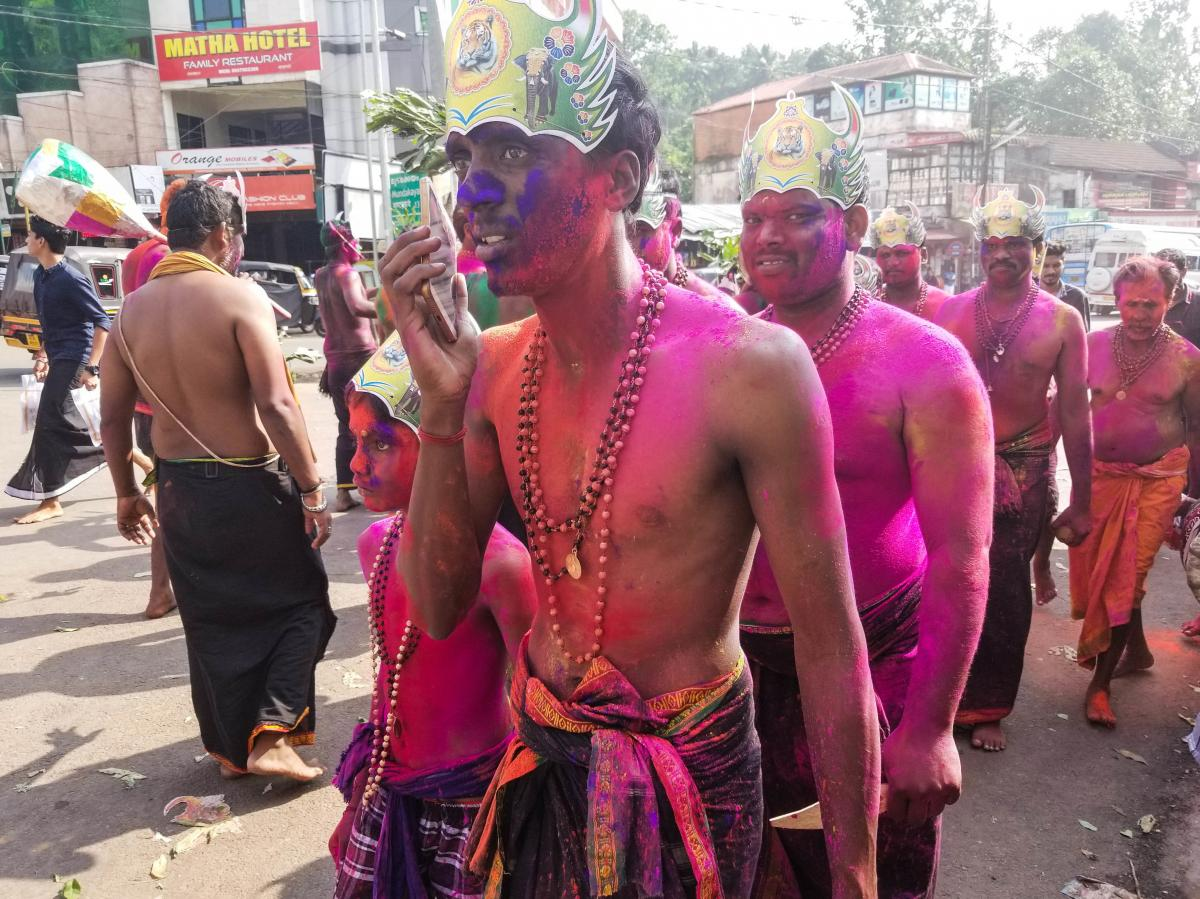 Male pilgrims with painted faces and wearing sarongs and beads walk through the streets in Erumely, on the pilgrimage route to the Sabarimala temple in southern India. Men of all ages are allowed to visit the temple, but women between the ages of 10 and 5