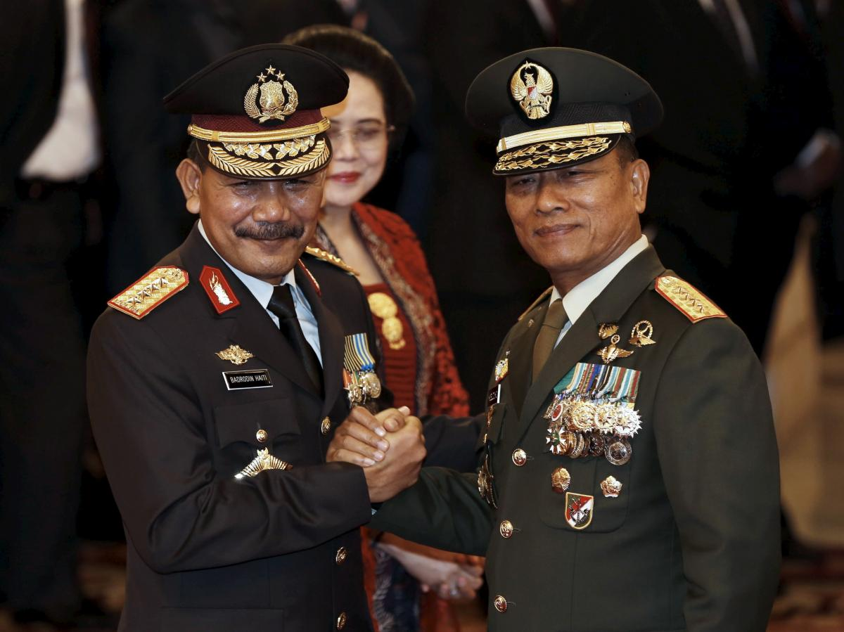 The head of Indonesia's Armed Forces Gen. Moeldoko (right) congratulates the country's new national police chief, Badrodin Haiti, last month. Moeldoko recently defended the Indonesian military's use of virginity tests for female recruits.