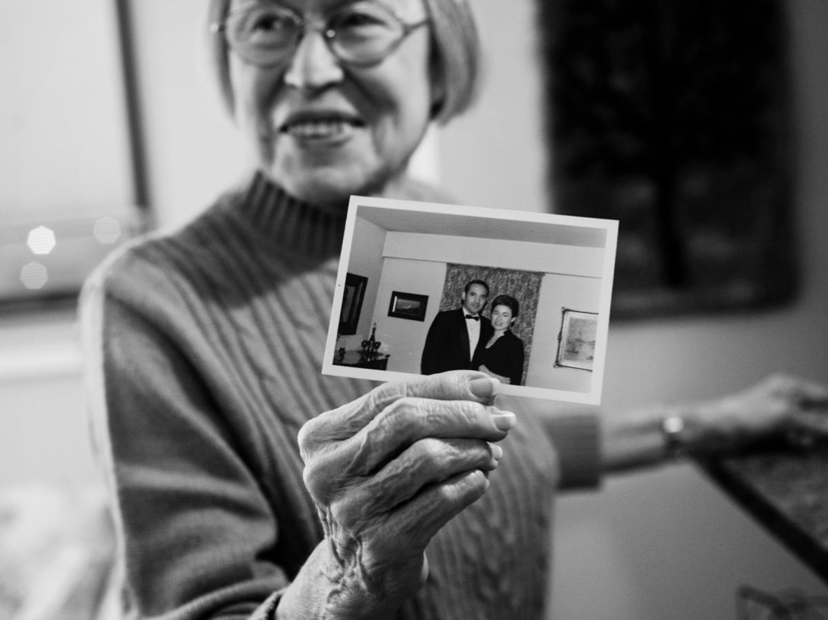 Lou Ann holds up photo of herself and Jay in their first apartment together in 1970.