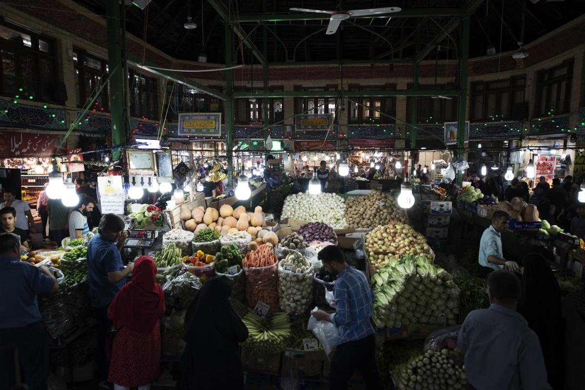 People shop in Tehran's Tajrish market. Iran faces high inflation. Food prices went up by more than 70% between July 2018 and July 2019, one economy expert says.