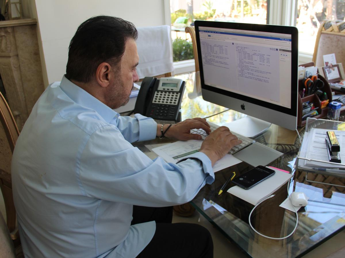 Travel agent Farhad Besharati moved his business into his home in April after some 20 years of it being in Persian Square, a strip in the Tehrangeles neighborhood of Los Angeles that has many Iranian American-owned businesses.