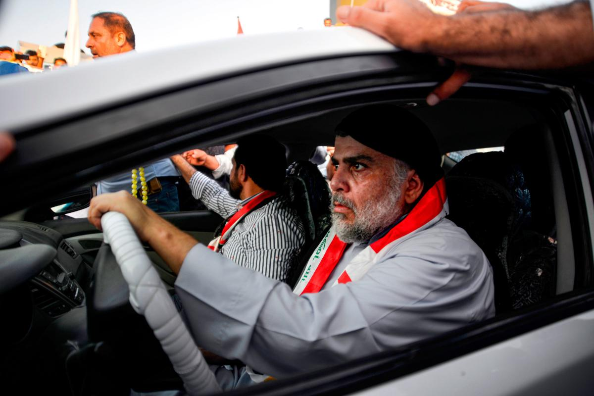 Iraqi Shiite cleric Muqtada al-Sadr drives a car as he joins anti-government demonstrators gathering in the central holy city of Najaf on Oct. 29, 2019.