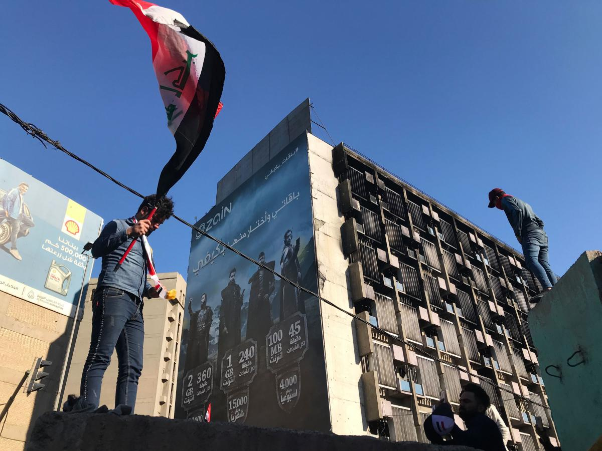 Protesters near Baghdad's Khilani Square, where security forces have opened fire on demonstrators trying to block roads.