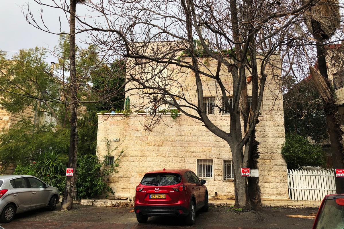 This apartment building, a short walk from the new U.S. Embassy in Jerusalem, is emblematic of Israelis' love-hate relationship with the city. On the ground floor, a religious Jewish Israeli man has moved in with his family. One floor up, a secular Jewish