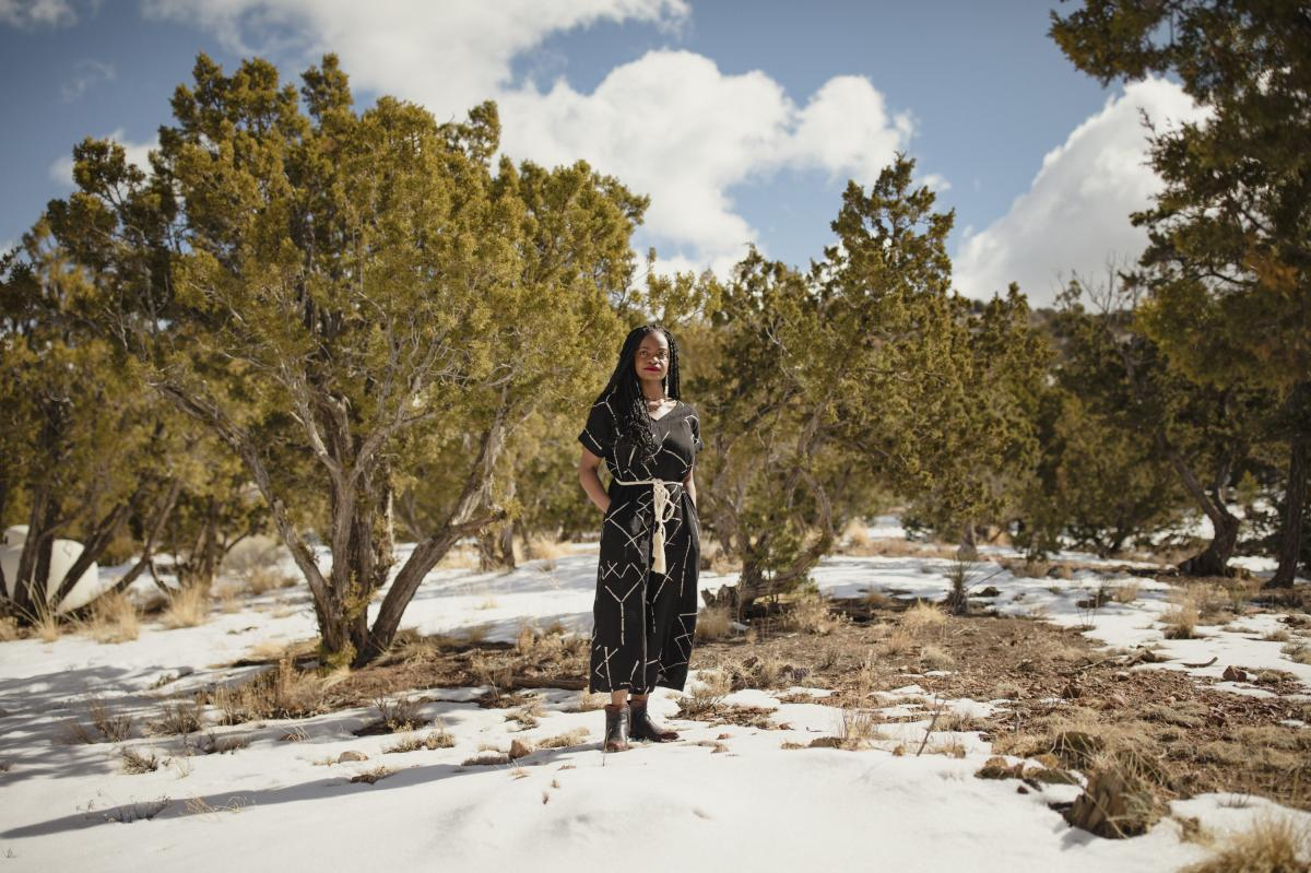Ifeoma Ozoma stands outside her home in Santa Fe, N.M.