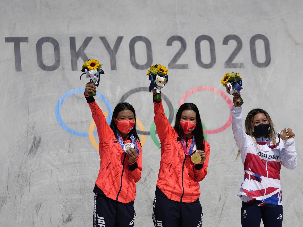 Silver medalist Kokona Hiraki of Japan (from left), gold medalist Sakura Yosozumi of Japan and bronze medalist Sky Brown of Britain pose during a medals ceremony for the women's park skateboarding at the Tokyo Olympics on Wednesday.