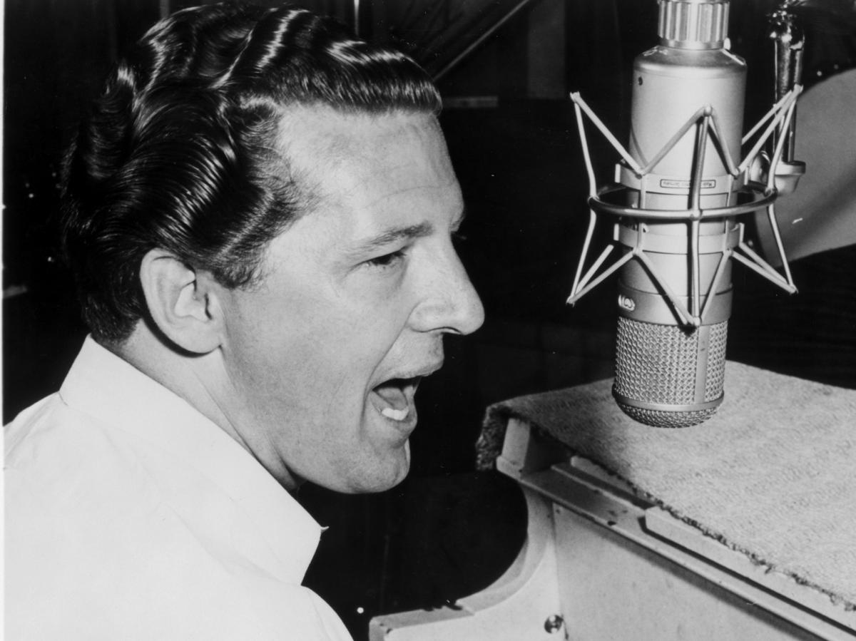 """Jerry Lee Lewis shot to fame in the 1950s with hits such as """"A Whole Lotta Shakin' Goin' On"""" and """"Great Balls of Fire."""""""