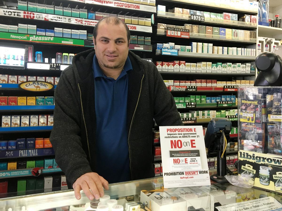 Sam Azar worries about how a ban on flavored tobacco products would hurt the bottom line at his Mission Smoke Shop in San Francisco.