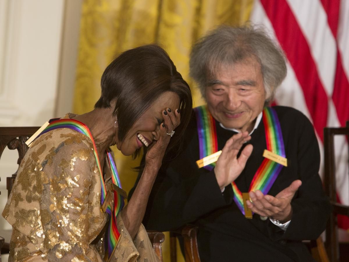 Cicely Tyson reacts to her introduction while conductor Seiji Ozawa, a fellow recipient of the Kennedy Center Honors, applauds during a reception at the White House on Dec. 6, 2015.