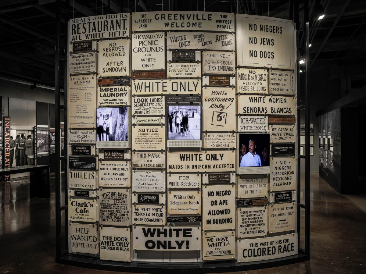 """Segregation posters are on display at the Legacy Museum in Montgomery, Ala. """"The great evil of American slavery wasn't involuntary servitude,"""" Stevenson says. """"It was this idea, this narrative, that black people aren't as good as white people."""""""