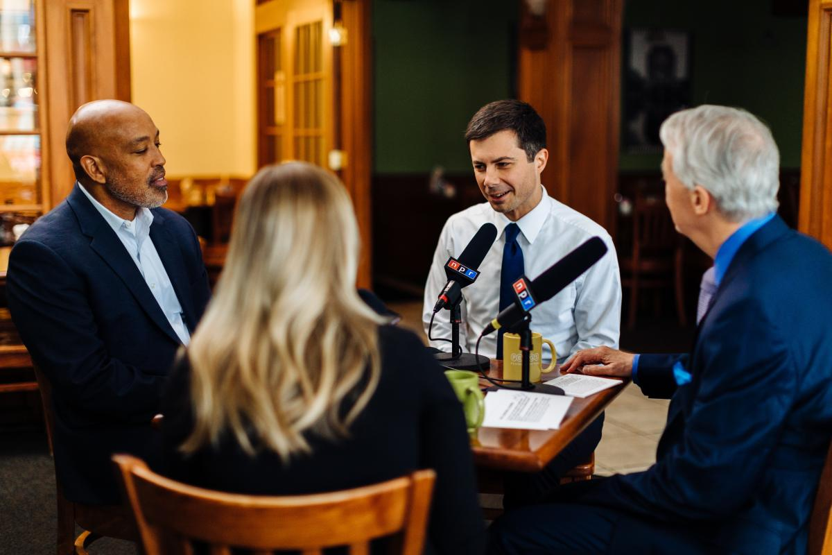 Buttigieg at Pegg's Diner in South Bend, Ind., with undecided voters Michael Logan and Jacque Stahl, along with NPR host Scott Simon.
