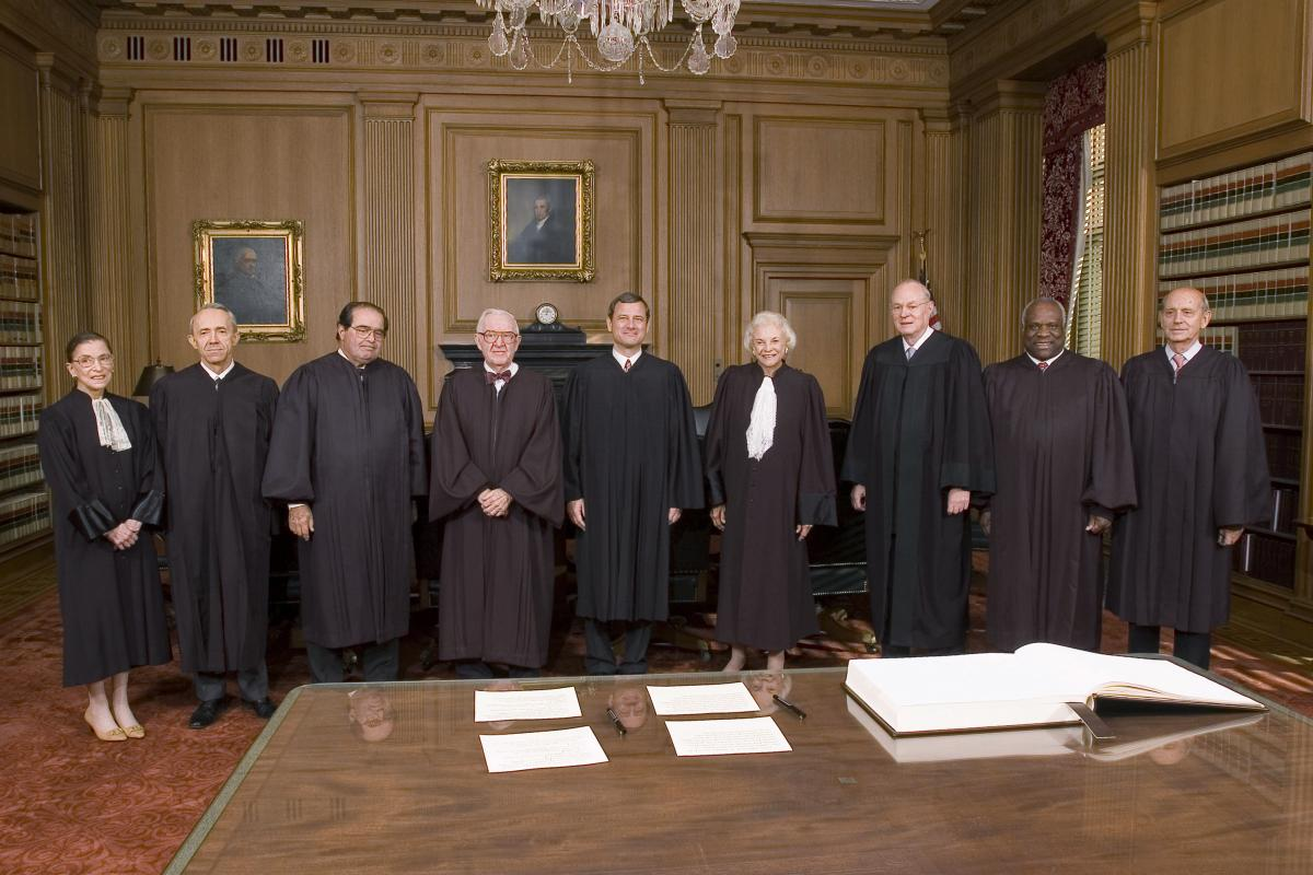 John Roberts (center) with the rest of the court after becoming chief justice on Oct. 3, 2005. The other justices pictured are Ginsburg (from left), David Souter, Antonin Scalia, John Paul Stevens, Roberts, Sandra Day O'Connor, Anthony Kennedy, Clarence T