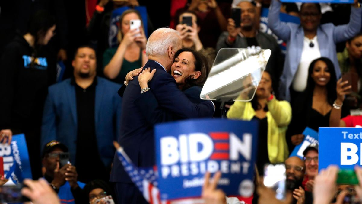 Harris hugs Biden after she endorsed him at a campaign rally in Detroit on March 9.