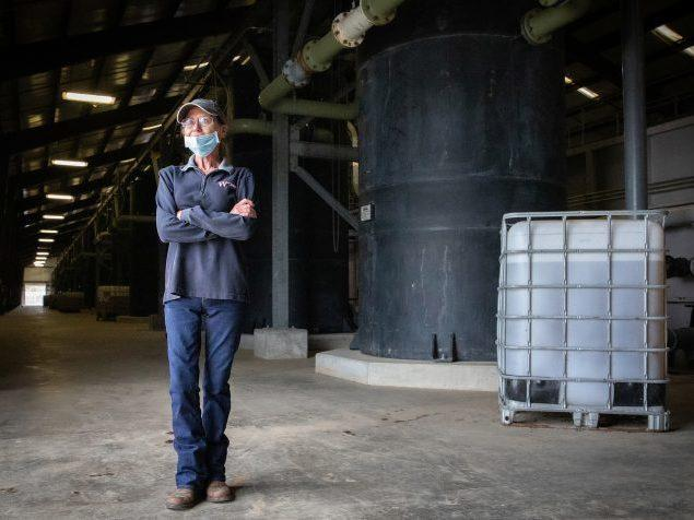 West Monroe Environmental Quality Manager Terry Emory stands in front of a multi-faceted wastewater treatment plant that ships clean water to a nearby paper mill. That partnership has cut down on industrial overuse of the region's precious groundwater res