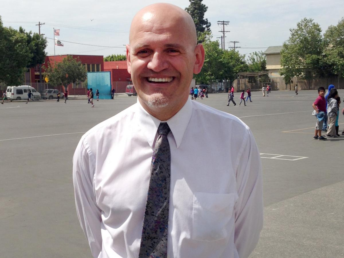 Tenth Street Elementary School's principal, Juan Alfayate, says he thinks the presence of two aides helps make the campus safer for students.