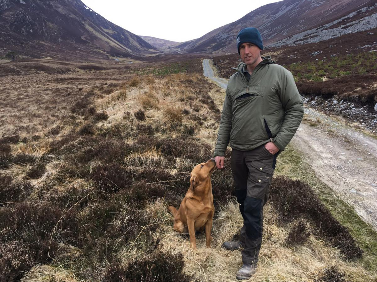 Reserve manager Innes MacNeill and his dog in the Alladale Wilderness Reserve.
