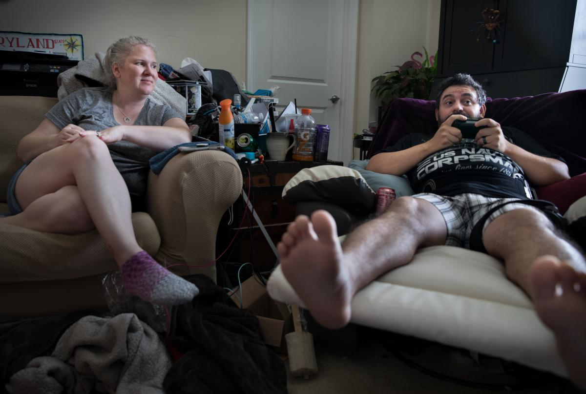 Michael Marquette plays video games while chatting with his wife, Jenn, as he heals from recent hip surgery.