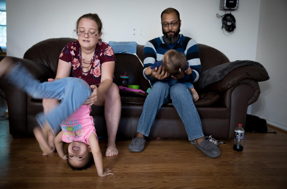 Beatrice Mahoney and Spencer Donerson Jr. play with their daughters, Jean and Tricia Donerson, ages 2 and 1, at their home in Gaithersburg, Md. Donerson, a Navy veteran, met Mahoney at the bowling alley when she was recovering from an injury sustained at