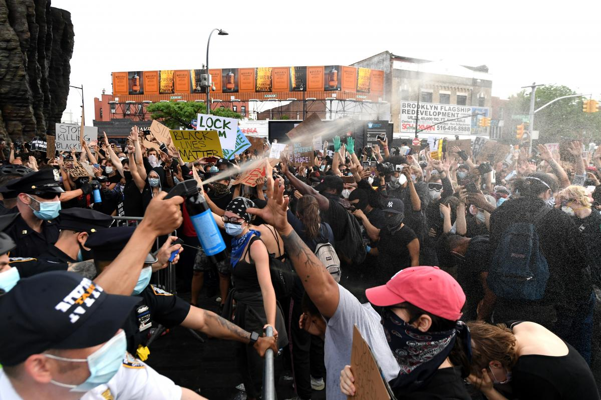 Police officers spray protesters outside Brooklyn's Barclays Center on May 29, 2020.