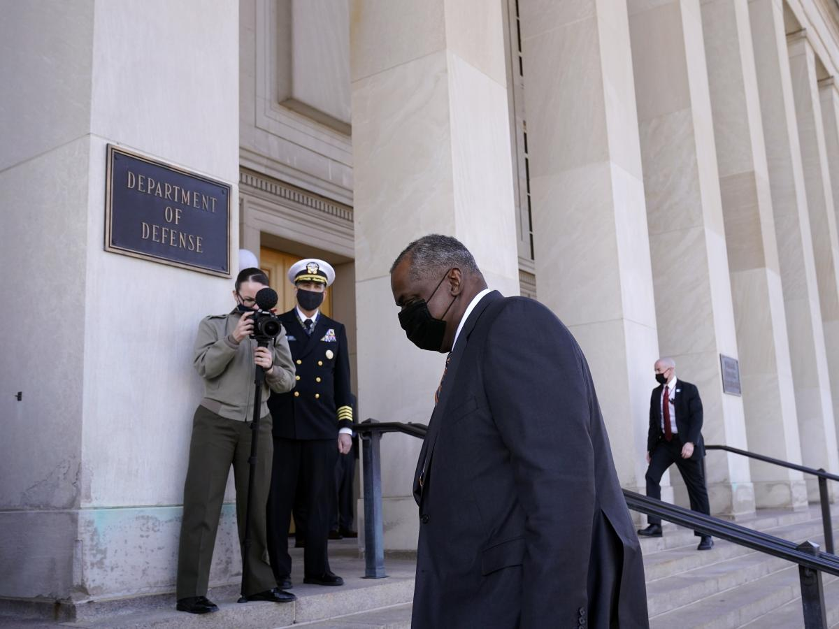 Retired Army Gen. Lloyd Austin arrives at the Pentagon on Friday. The Senate confirmed him as defense secretary by a 93-2 vote.