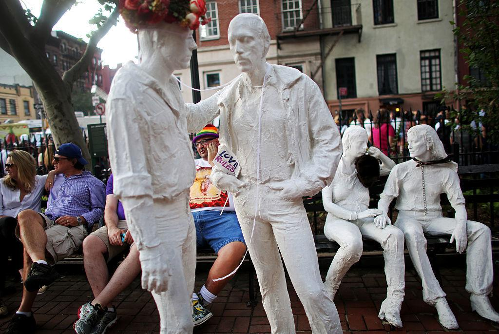 """After much controversy, George Segal's sculpture """"Gay Liberation"""" was installed in Christopher Park, located across the street from the Stonewall Inn. A crowd gathered at the site in 2015 to celebrate the U.S. Supreme Court decision legalizing same-sex ma"""