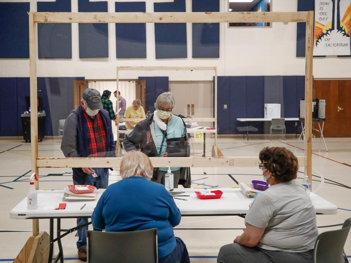 A couple checks in to cast their ballots at the Kenosha Bible Church gym in Kenosha, Wis., on Tuesday.