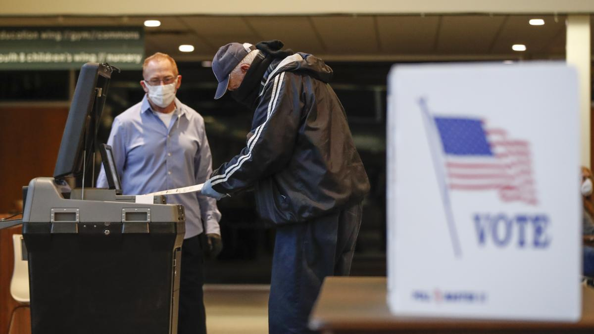 A man casts his ballot in a Democratic presidential primary at Journey Church in Kenosha, Wis.
