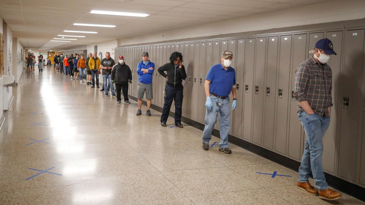People wait in line to vote at Hamilton High School in Milwaukee.