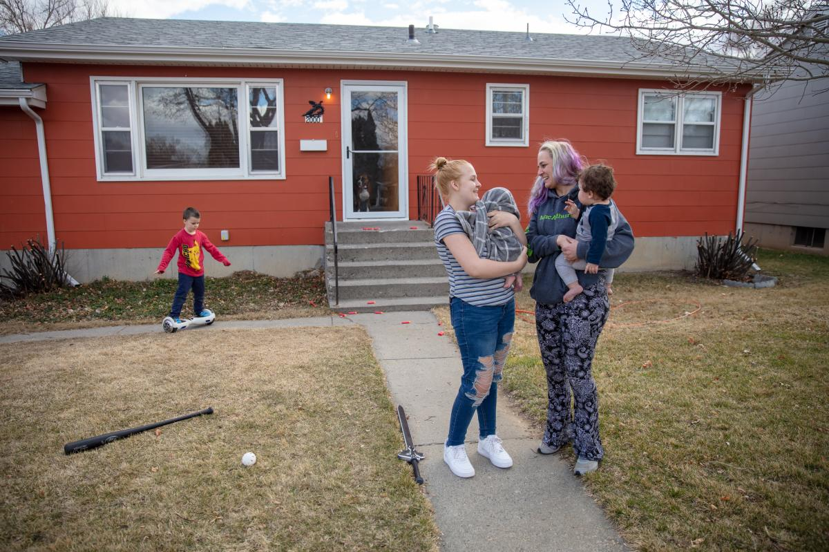 Gaught (right) holds her 9-month-old grandson, Adonis, while her daughter Trinity, 16, holds her newborn baby at the home they now rent in Billings, Mont. Gaught's 5-year-old son, Blazen, plays in the background. She says out of all of them, Blazen has be