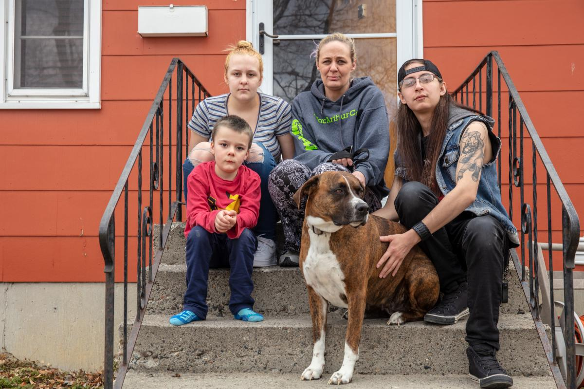 """Gaught sits outside the house she now rents in Billings with her three children. The family had to leave suddenly when they were evicted, and still haven't been able to find a cat they had at the mobile home park. """"We looked and called around forever and"""