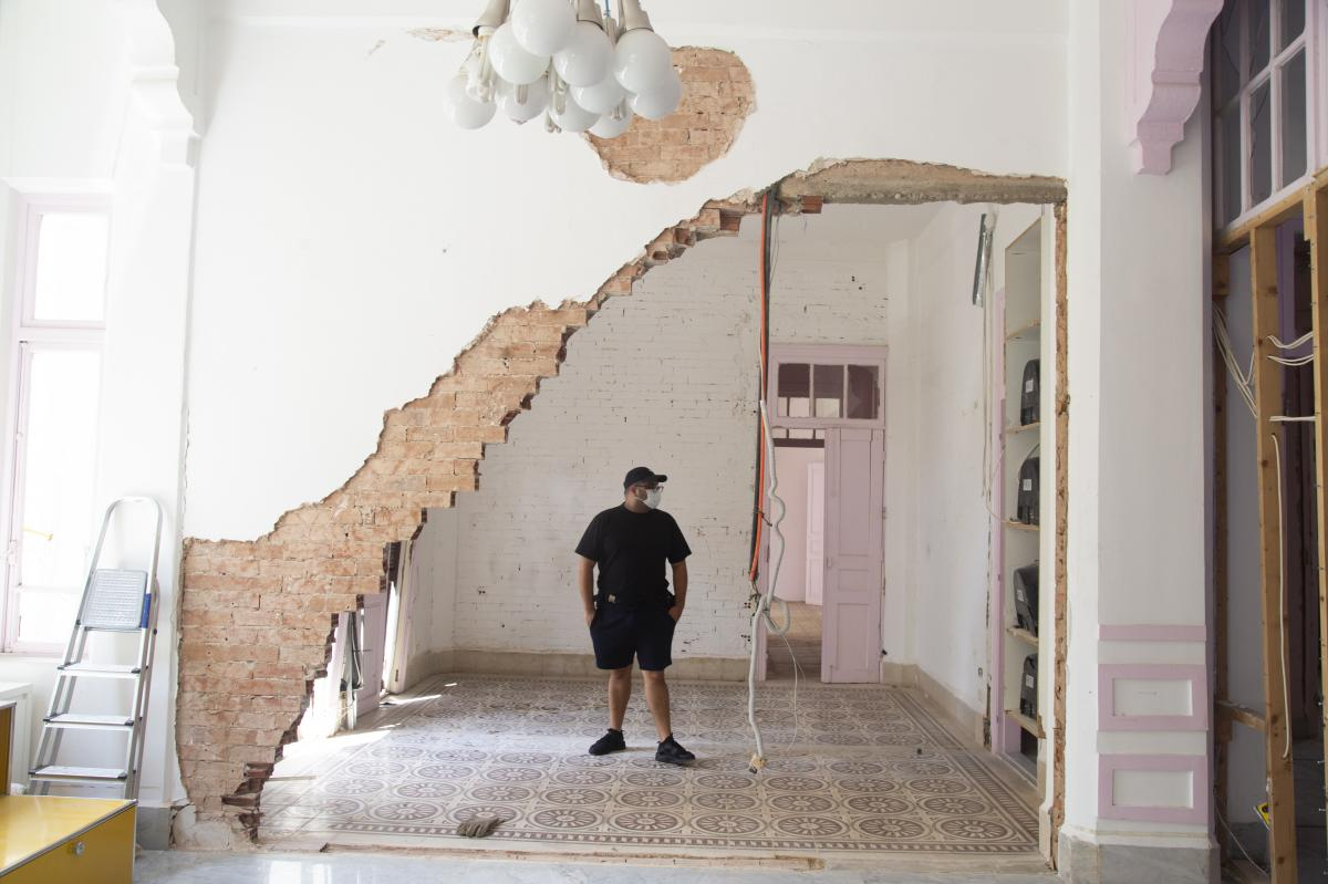 """Eli Rezkallah, owner and founder of Plastik Studios, walks around his office in the neighborhood of Gemmayzeh. """"To me Plastik's mere existence was to add colors and light to a war-torn city."""""""