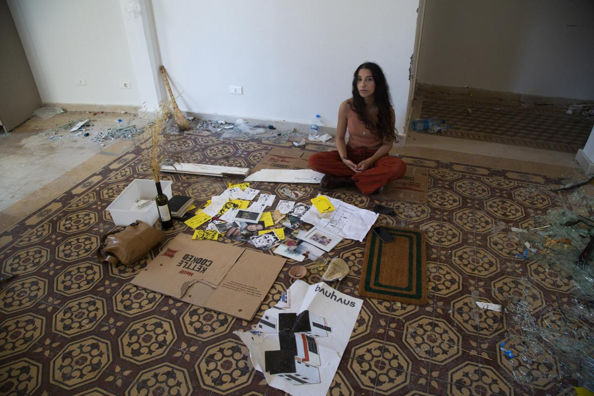 Karen Madi, a resident of the neighborhood of Rue Pasteur who works at a gallery in the Karantina neighborhood. Her family emigrated but she chose to stay in Lebanon to build her own home and future.