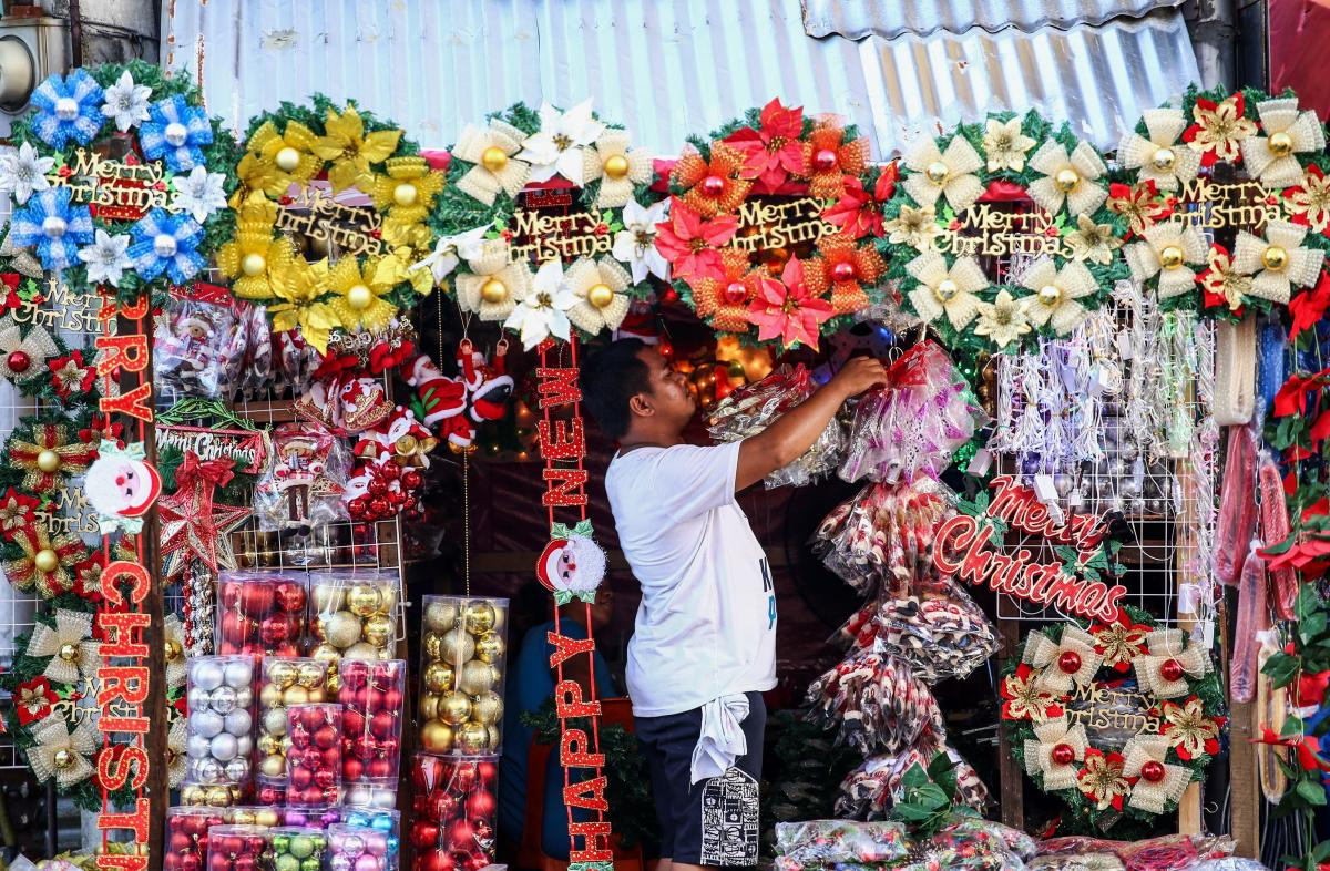 A worker arranges Christmas decorations from a street stall in Manila on Sept. 23. The Philippines, Asia's only Christian majority country, celebrates Christmas season for several months.