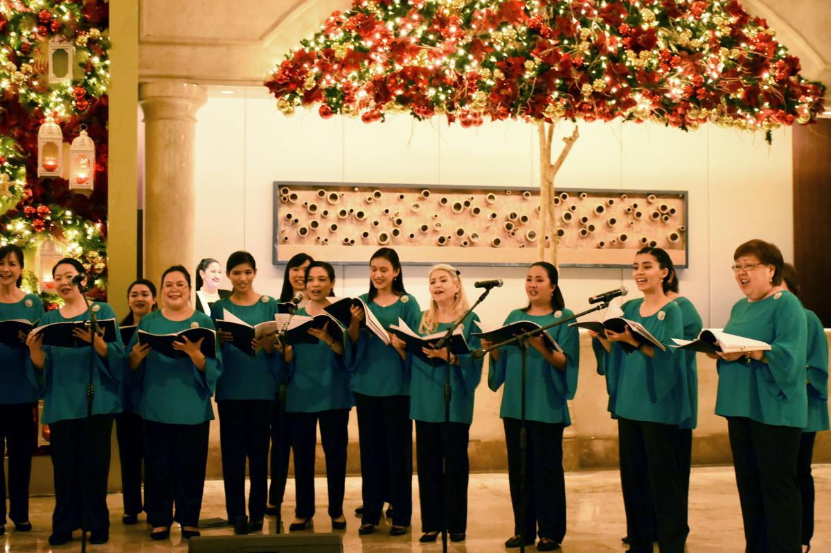 Mary the Queen Parish Church Choir performs in Manila's Peninsula Hotel. Musicians and performing artists of all kinds stage programs in hundreds of venues in the capital during the Christmas season.