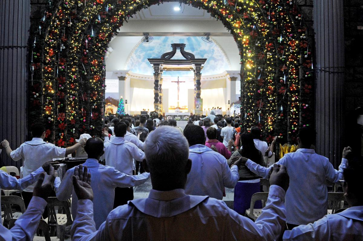 Colorful lights outline the doorway of a Roman Catholic church as Filipinos attend the first of nine dawn Masses, signaling the official start of the Christmas season in suburban Manila on Dec. 16, 2015. Mass is celebrated over nine-consecutive days until