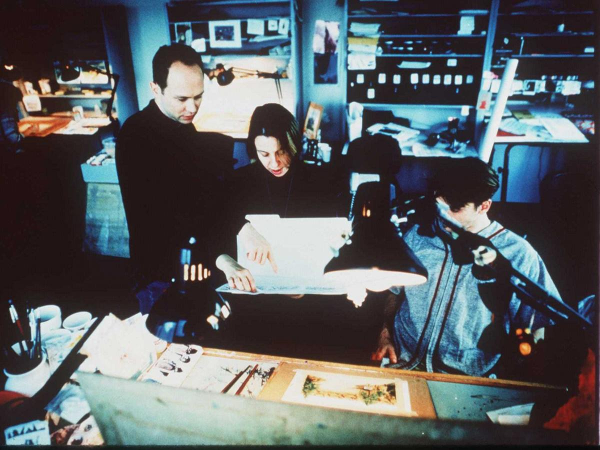 Beavis and Butt-Head creator Mike Judge (left) and animation director Yvette Kaplan (center) work on the production of the 1996 motion picture, Beavis and Butt-Head Do America. From its debut in the early 1980s, MTV proved itself to be a pioneer in adult