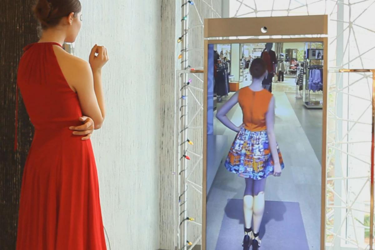 """Neiman Marcus is testing a digital """"Memory Mirror"""" that uses video to let shoppers see how outfits they have tried on look from the back."""