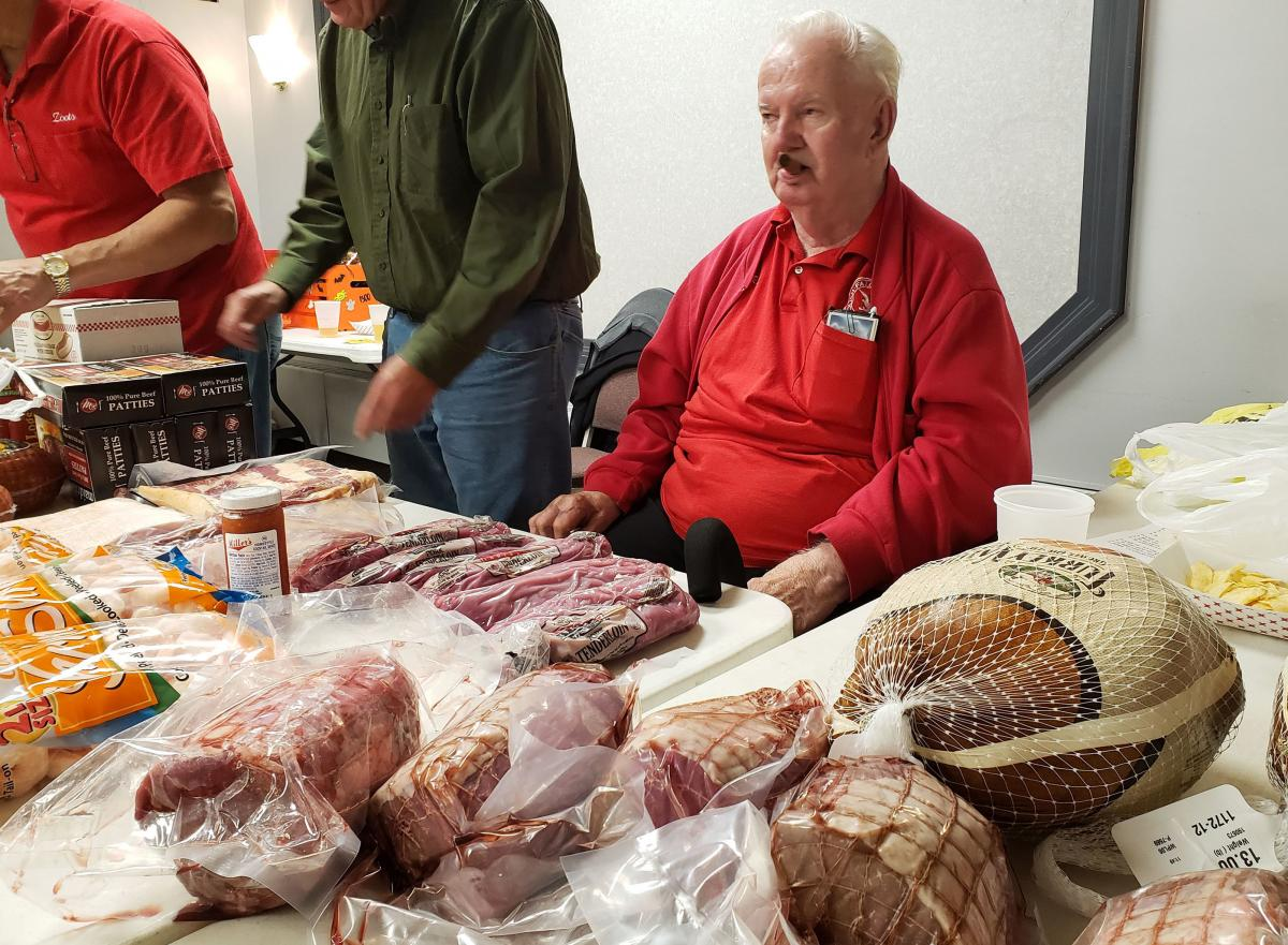 Meat sentry Ray Stack oversees raffle prizes at the Polish Falcons Hall in Depew, N.Y.
