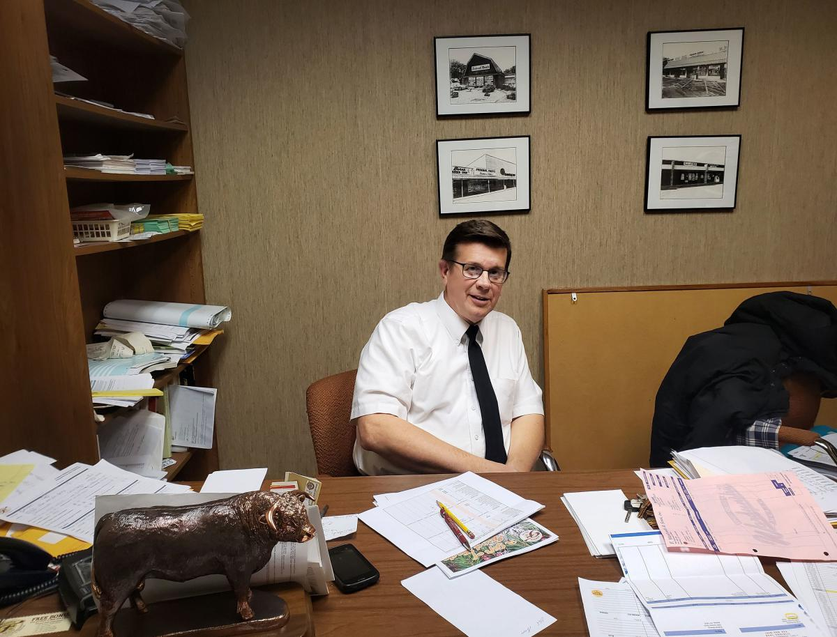Federal Meats Supervisor Tom Benzin works early Saturday morning in his Buffalo, N.Y., office.