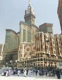 The Clock Tower Hotel overlooks passersby at the Grand Mosque.