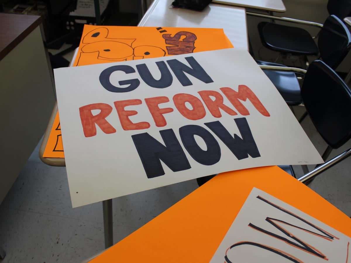One poster made by students at Ridgefield High School in Connecticut for the school walkout.
