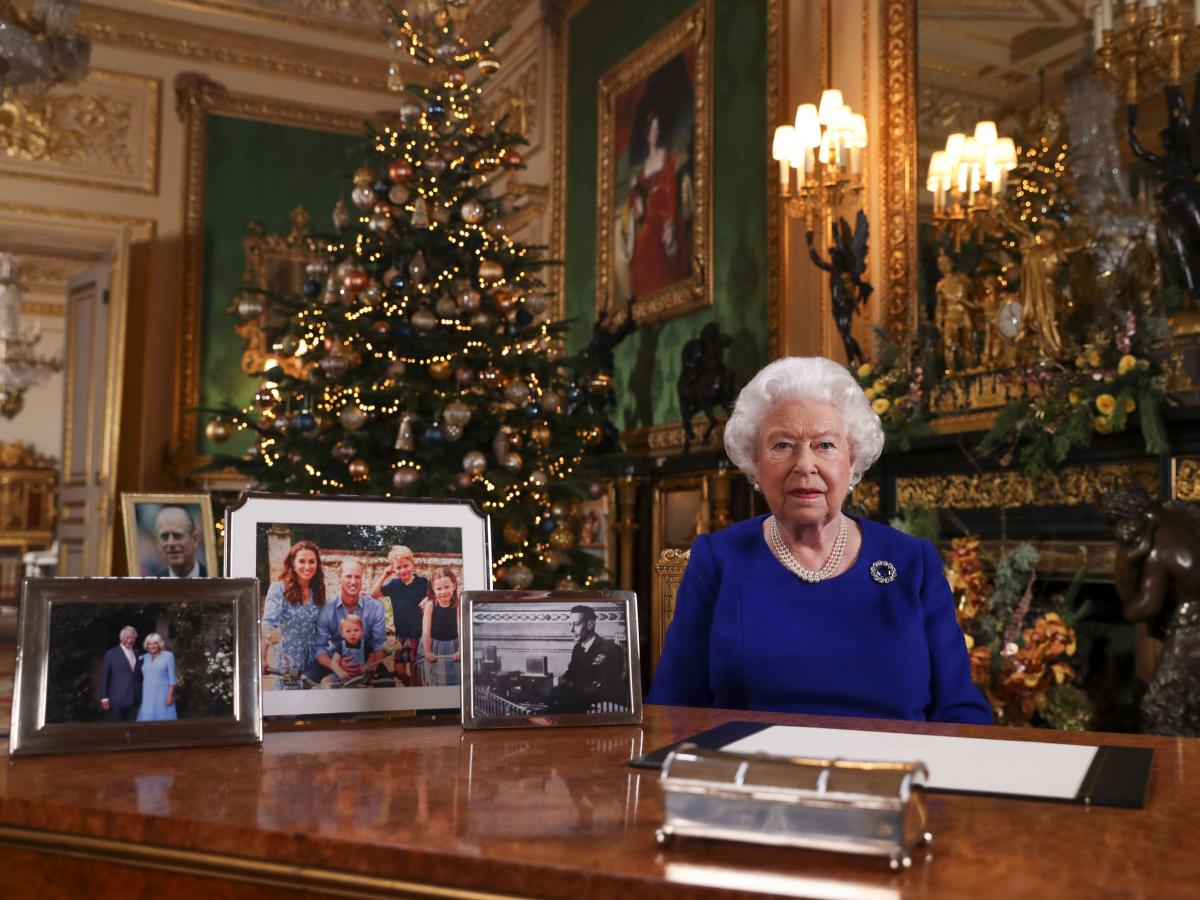 Britain's Queen Elizabeth II posed for a photograph after she recorded her annual Christmas Day message last month. Royal watchers noticed the absence of a photo of Meghan and Prince Harry amid the other family photos displayed.