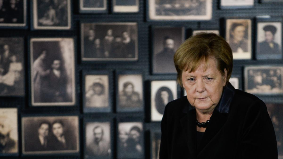 German Chancellor Angela Merkel spoke to the media Friday during an event marking the 10th anniversary of Auschwitz Foundation. During the address, she stood in front of the portraits of Jews imprisoned and killed at the death camp.