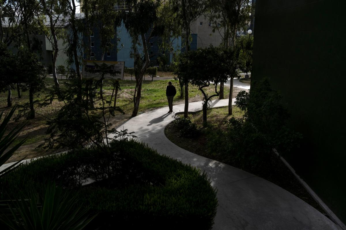 A male student walks in the Otay Campus at the Universidad Autonoma de Baja California in Tijuana. Offices, classes, streets and transit were emptier than usual.
